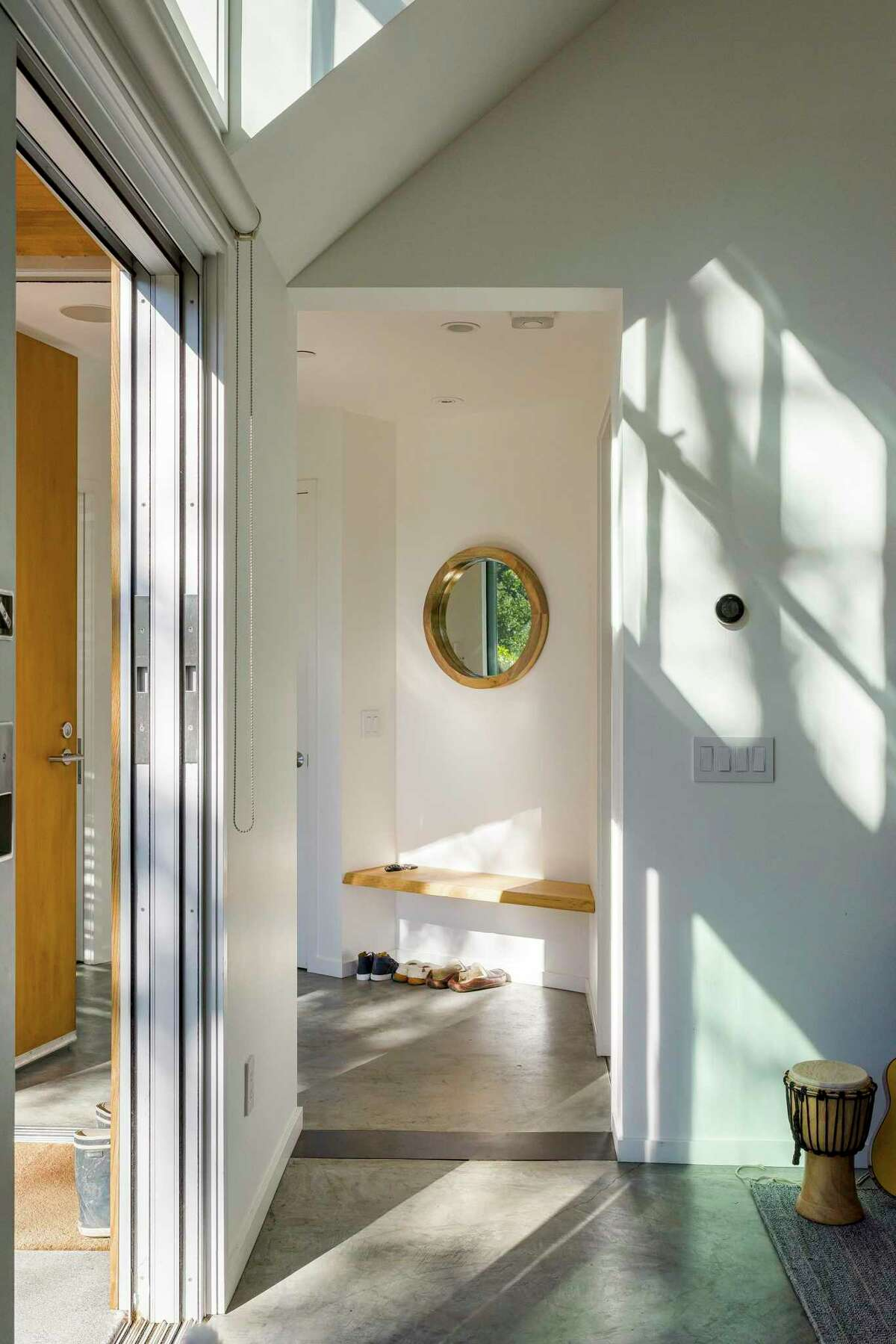 Architect Melanie Turner, director of residential design for Perkins&Will's San Francisco office, installed a built-in bench in the entryway of this Mill Valley home to give residents and guests a place to take off and store their shoes before entering further into the home.