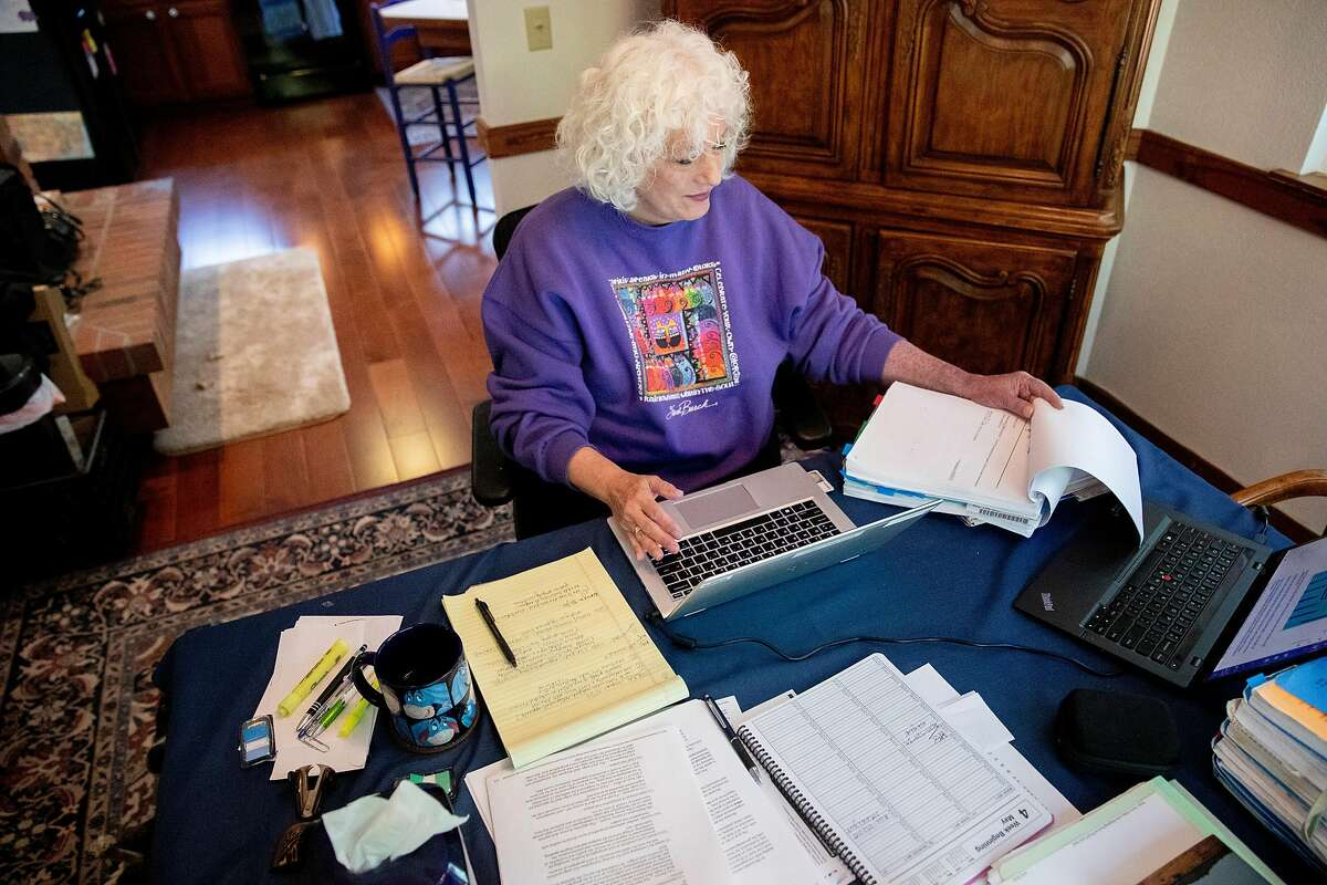Judge Dana Leigh Marks works from her dining room at her home in Mill Valley, Calif. Wednesday, May 6, 2020. Immigrant advocates say the precise policies this administration has pursued will make it all the more difficult to get the courts back to functioning efficiently, potentially pushing hundreds of thousands of cases off for years.