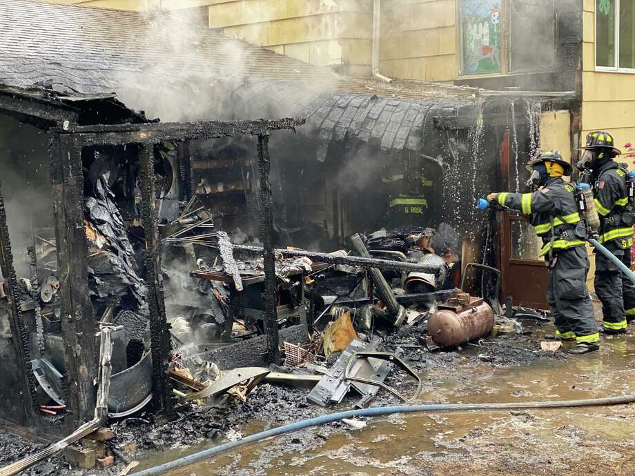 Firefighters from Monroe Volunteer Fire Department, Stepney Fire Department and Stevenson Volunteer Fire Company responded to a Pastors Walk house fire Friday, May 8. Photo: Monroe Volunteer Fire Department / Contributed Photo / Connecticut Post