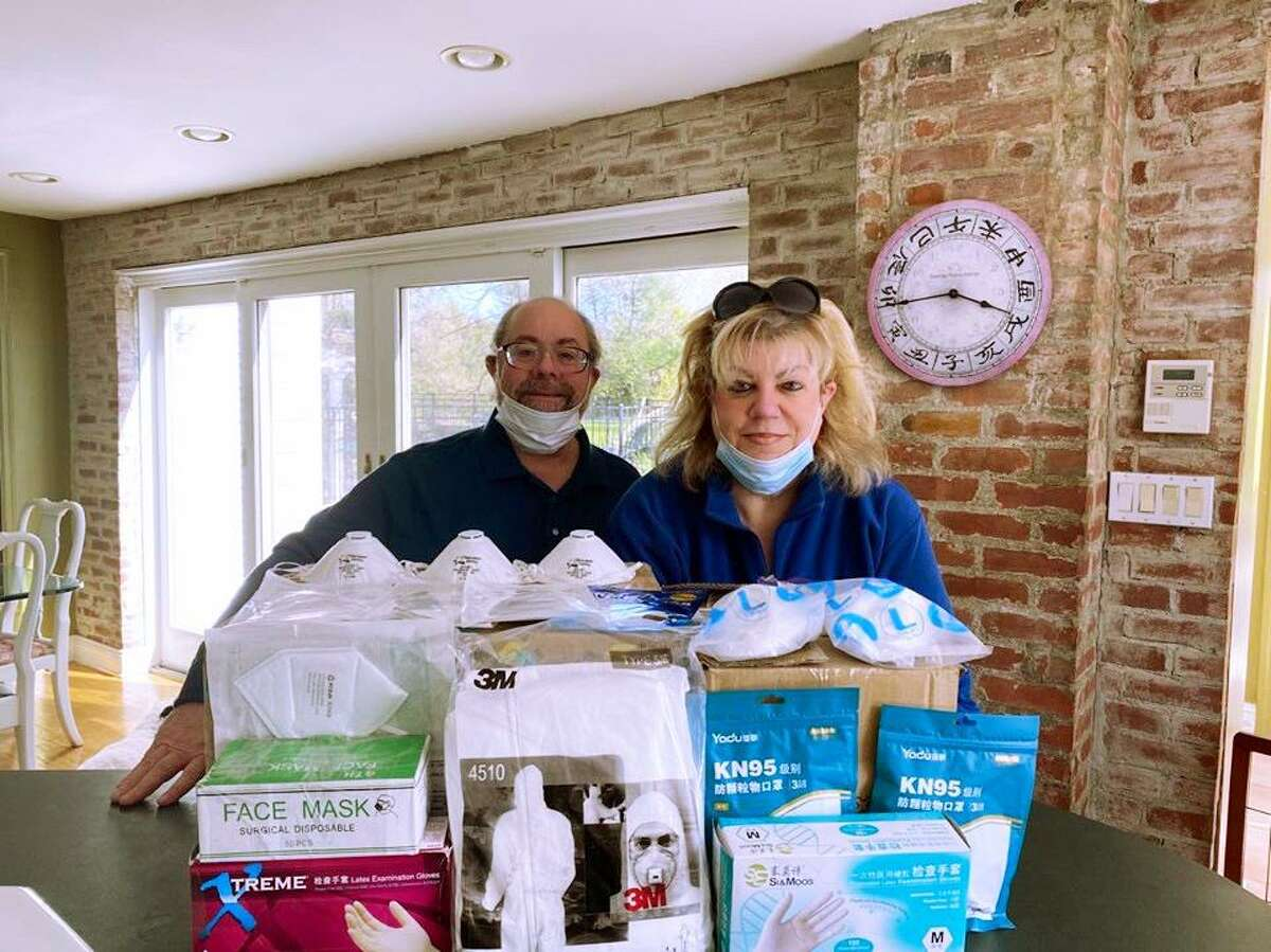 Marshall and Barby Marcus with some of the personal protective equipment they recently donated to Trumbull.