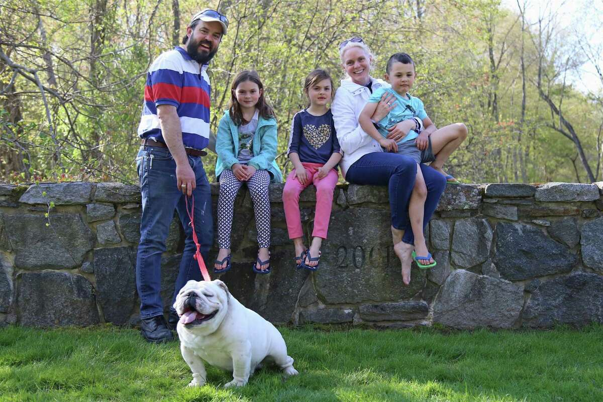 A family portrait including, from left, Pablo Sherwell of Westport, Carolina, 8, Elizabeth, 6, Jennifer Christian, Pablo Jr., 6, and Max, on Mother's Day, May 10, 2020, in Westport, Conn.