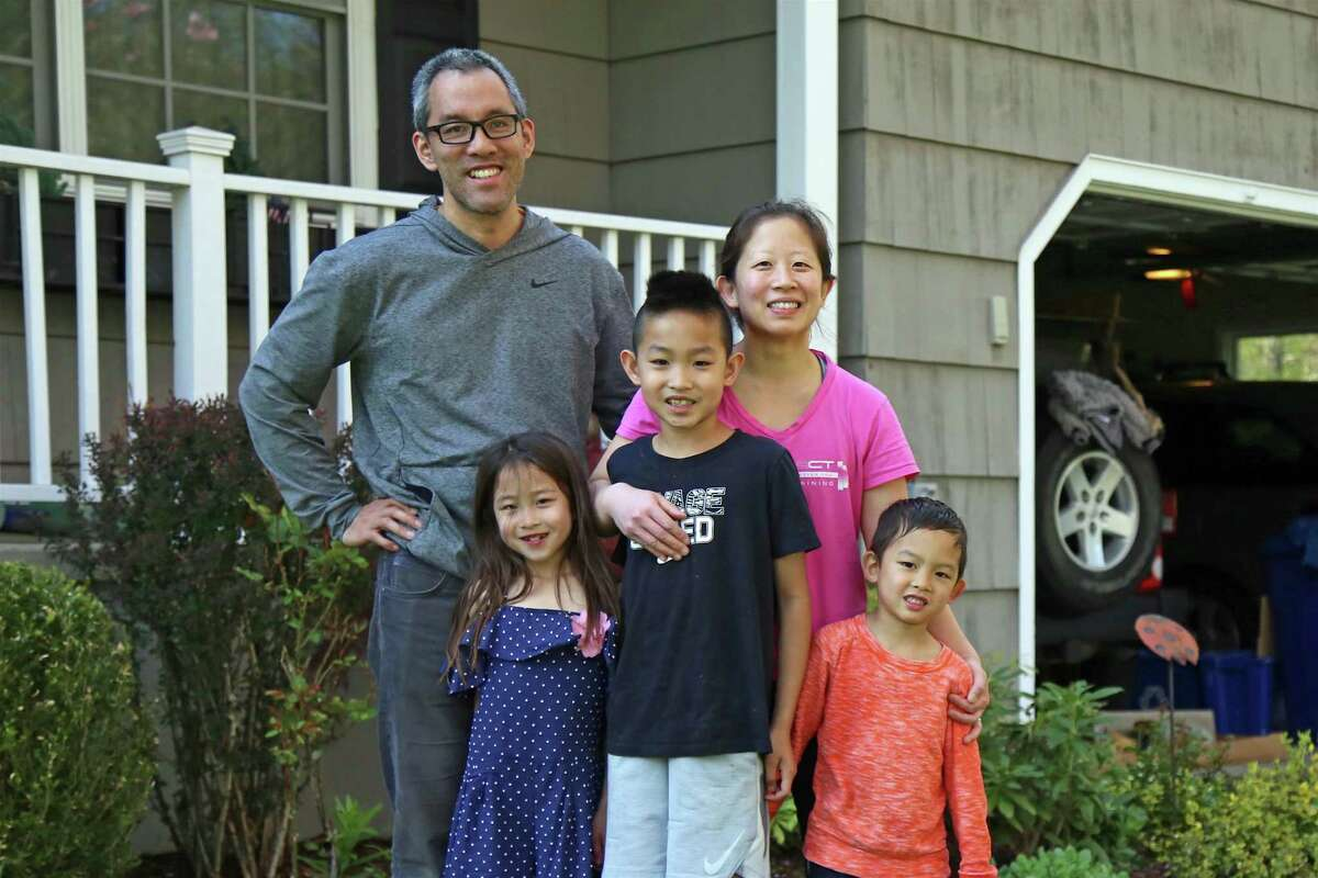 The Calejesan family of Westport takes a break from some yard work on Mother's Day, May 10, 2020, in Westport, Conn.