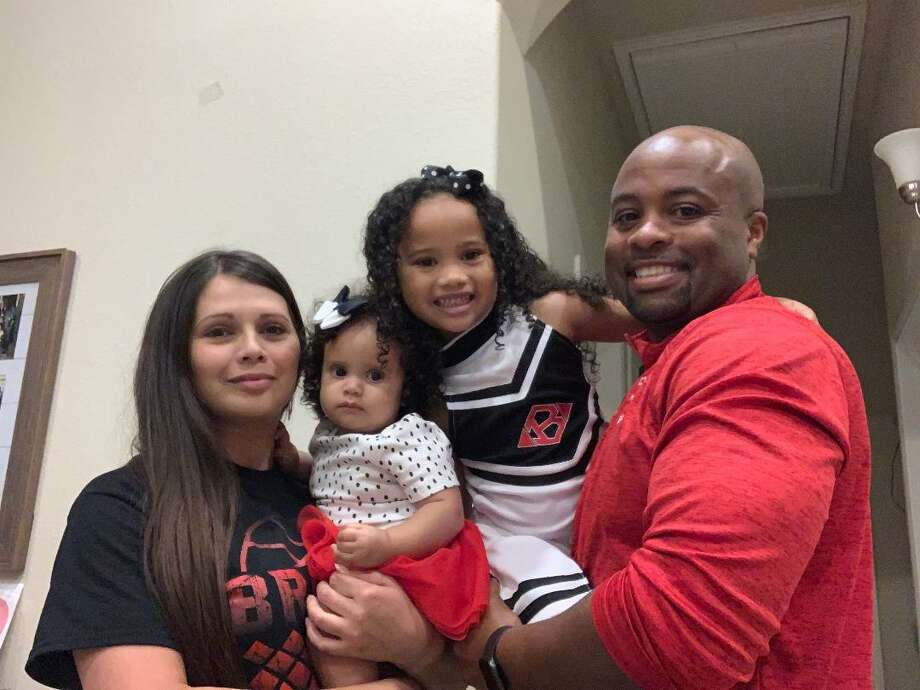 Warren Brooks has been named head coach of the Clear Brook varsity girls basketball team. Brooks is shown (left to right) with his wife, Karen, and daughters Mikaela, 11 months, and Anahi, 5. Photo: Submitted Photo