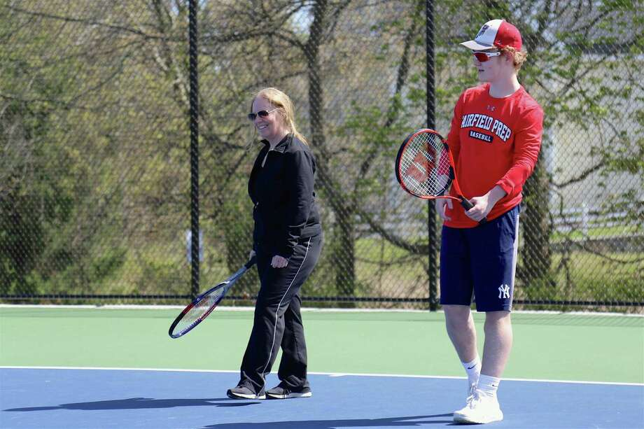 Maureen Martin of Fairfield and her son Jack, 16, share some time on the court on Mother's Day, Sunday, May 10, 2020, in Fairfield, Conn. Photo: Jarret Liotta / Jarret Liotta / ©Jarret Liotta 2020