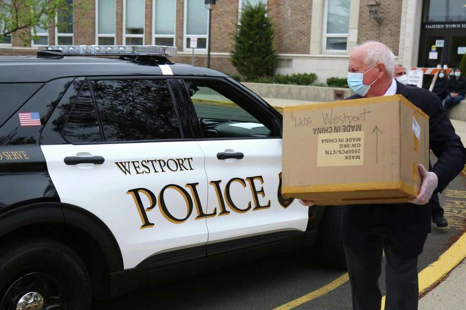 Westport's First Selectman Jim Marpe picks up the donation of mask for Westport first responders on Wednesday at Town Hall in Darien. Taken April 8, 2020. Photo: Jarret Liotta / For Hearst Connecitcut Media / Jarret Liotta