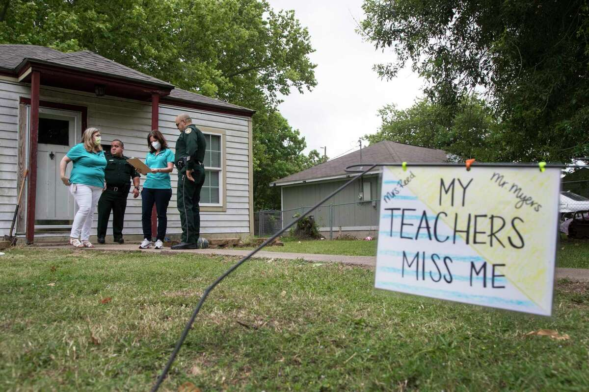 Roosevelt-Wilson Elementary Principal Wendy Patterson and assistant principal Angela Randall, of Texas City ISD, work with deputies Cipriano Ruiz and Louis Maldonado to reach out to some of their students on Friday, May 8, 2020 in Texas City.