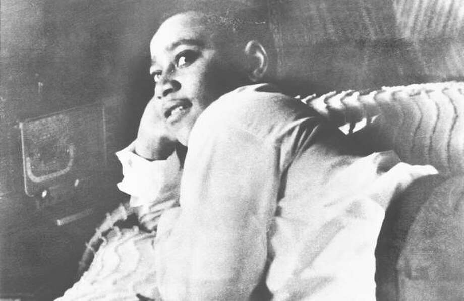 Emmett Till is shown lying on his bed. Photo: Getty Images