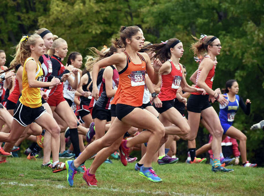 Edwardsville runner Abby Korak, front, gets off to quick start at the Class 3A Quincy Regional. Edwardsville senior Melissa Spencer runs in a race during her final season with the Tigers. Photo: Intelligencer Sports Staff