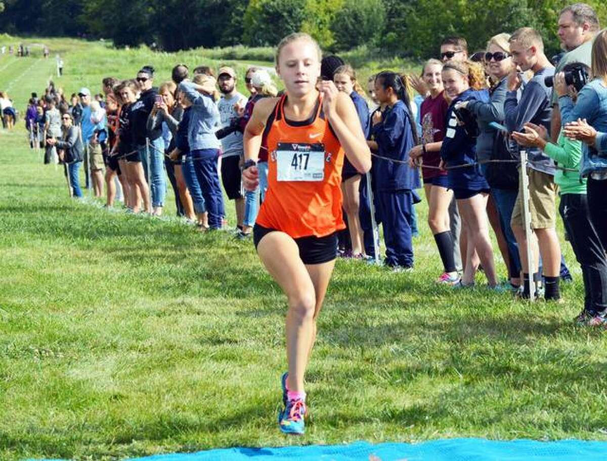 Edwardsville runner Abby Schrobilgen wins the girls' race of the Tiger Classic at the SIUE cross country course.