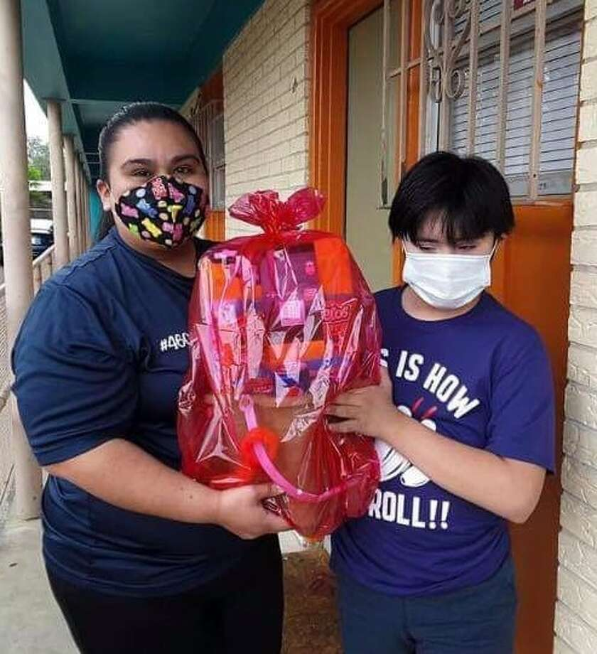 Special Olympics athlete Kevin Martinez poses with a gift basket he received from his sponsor.      Photo: Courtesy Photo