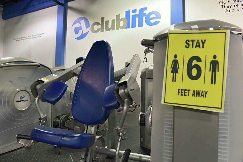 Signs to stay six feet apart are seen at Club Life Health and Fitness on Monday, May 11, 2020 in Valatie, N.Y. Owner Alex Rosenstrach held a rally today to end the Coronavirus Pause mandate for small businesses. (Lori Van Buren/Times Union)