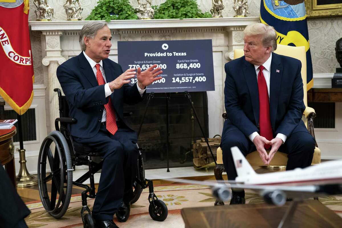 Greg Abbott, governor of Texas, left, speaks while U.S. President Donald Trump listens during a meeting at the White House in Washington, D.C., U.S., on Thursday, May 7, 2020. Trumpis promoting Texas for following his call to reopen the economy even as the U.S. continues to fight the coronavirus outbreak. Photographer: Doug Mills/The New York Times/Bloomberg