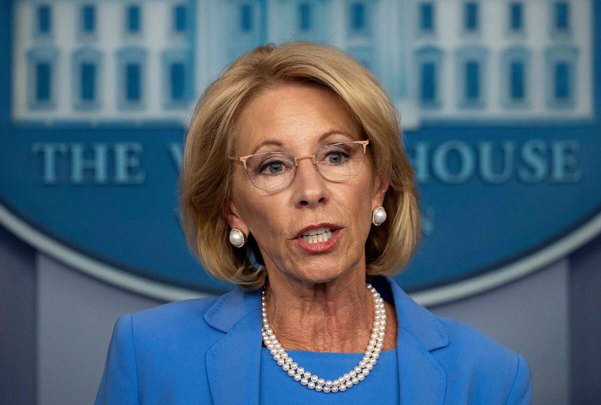(FILES) In this file photo taken on March 27, 2020 US Secretary of Education Betsy Devos speaks during the daily briefing on the novel coronavirus, COVID-19, in the Brady Briefing Room at the White House in Washington, DC. - The US Department of Education published new rules May 6, 2020, which strengthen the rights of the accused in cases of sexual harassment or assault in schools and universities. Under the changes, which were immediately slammed by victims groups, an accused person must be notified of the charges against him or her, may have recourse to a lawyer and has the right to a hearing to defend him or herself. (Photo by JIM WATSON / AFP) (Photo by JIM WATSON/AFP via Getty Images)