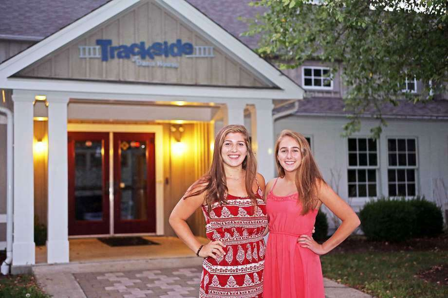 Former Safe Rides presidents Cecilia Babchak and Maddie Gilliespie pose for a photo outside of the Trackside Teen Center in Wilton. The Wilton Board of Selectmen is considering cutting Trackside's grant. Photo: Contributed Photo