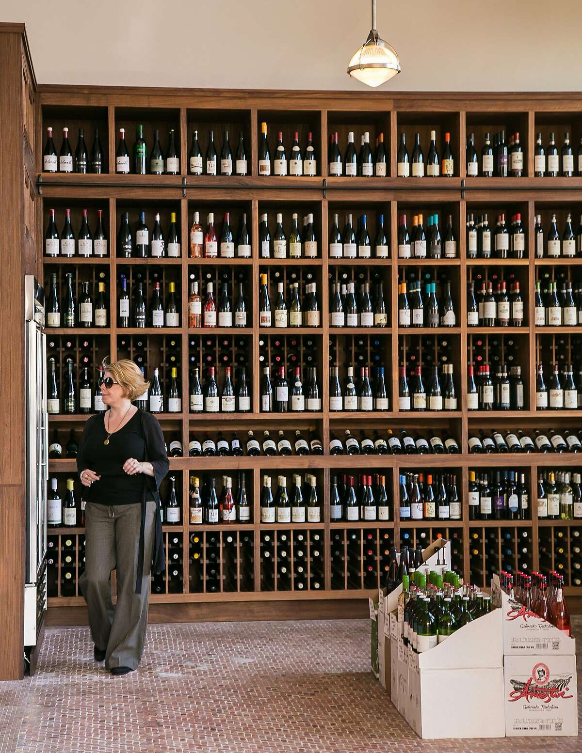 A woman browses the wines for sale at Tofino in San Francisco, Calif., on June 2nd, 2015.
