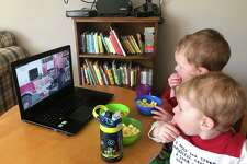 Nathaniel and Charles Dey of Wilton watch Firefighter Story Time from their home. In conjunction with Wilton Library, each Friday from 10 to 10:30 a.m., Wilton firefighters read stories to children on Zoom. Registration for this program is required at wiltonlibrary.org/events. For questions, email aszabo@wiltonlibrary.org.