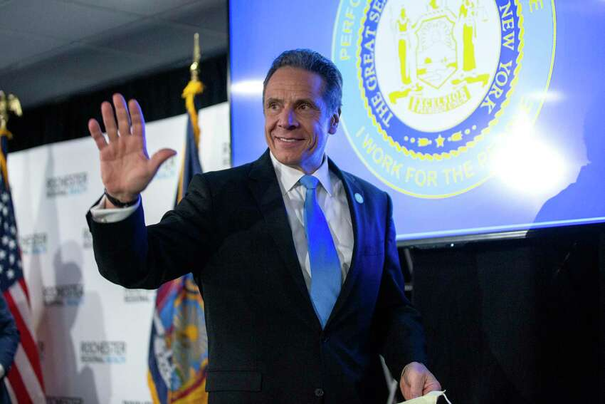 New York Gov. Andrew Cuomo departs a news conference at the Rochester Regional Health Riedman Campus Training Center in Irondequoit, N.Y., Monday, May 11, 2020. In the most concrete step toward restarting his battered and shuttered state, Cuomo announced on Monday that three upstate regions might partially reopen this weekend, with limited construction, manufacturing and curbside retail.