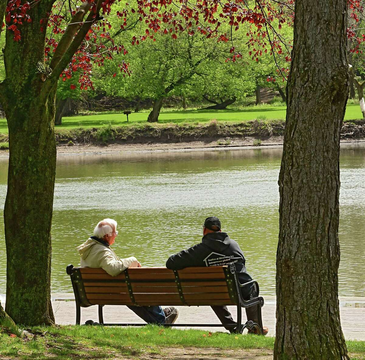 Warm weather is on the way, you'll just have to sit tight for a few more days to get it if you live in the Capital Region, Times Union meteorologist Jason Gough says. In this photograph, two men sit on a park bench overlooking the Mohawk River near the Waterford Visitors Center on Monday, May 11, 2020 in Waterford, N.Y. (Lori Van Buren/Times Union)