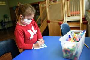 Elementary student Gioia Judge draws at the YMCA of Greenwich Early Learning Center in the Chickahominy section of Greenwich, Conn. Wednesday, April 29, 2020. The YMCA joined the state's CTCARES program to offer free child care services for Greenwich Hospital employees.