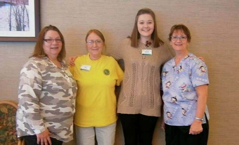 From left, Suzette (activity aide), Deb (activity aide), Aubrey Mielens, and Agnes (activity aide) at Stratford Pines Nursing & Rehab. (Photo provided)