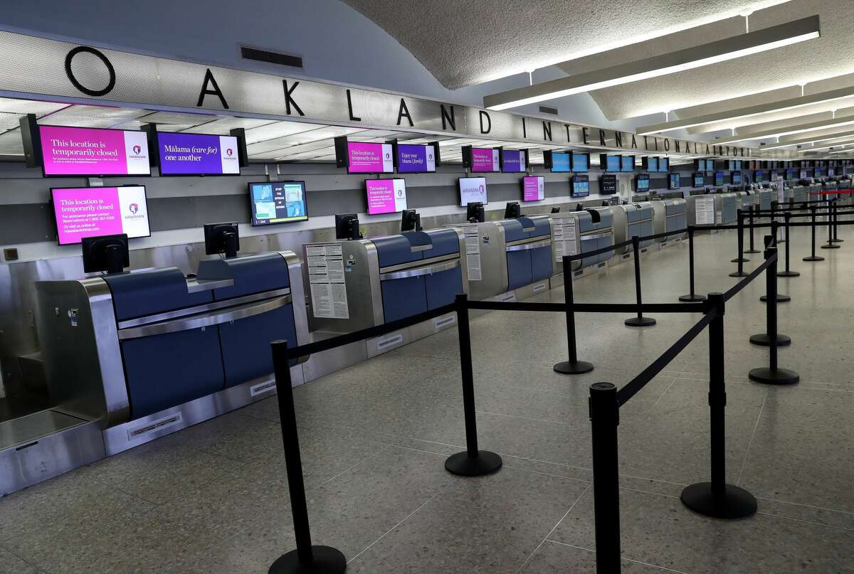 Empty counters are seen at Oakland International Airport's Terminal 1 in Oakland, Calif., on Monday, April 6, 2020. The airport was nearly deserted as the coronavirus pandemic continues.