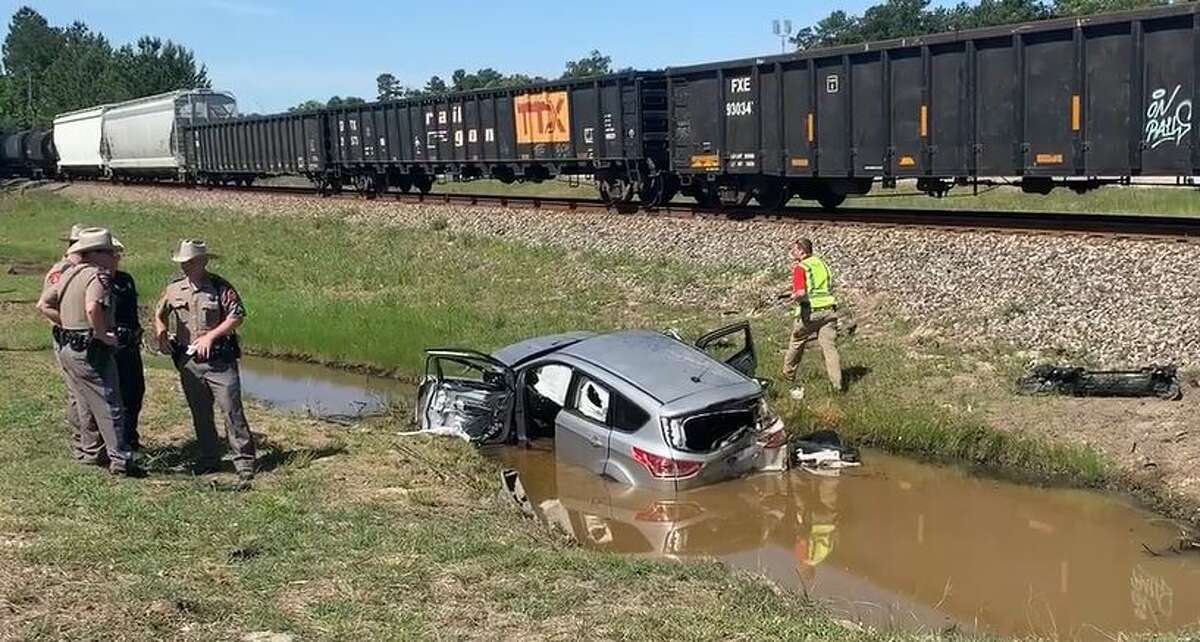 A woman traveling through Splendora on Monday morning lost her truck to an oncoming train when she tried to beat it across the tracks.