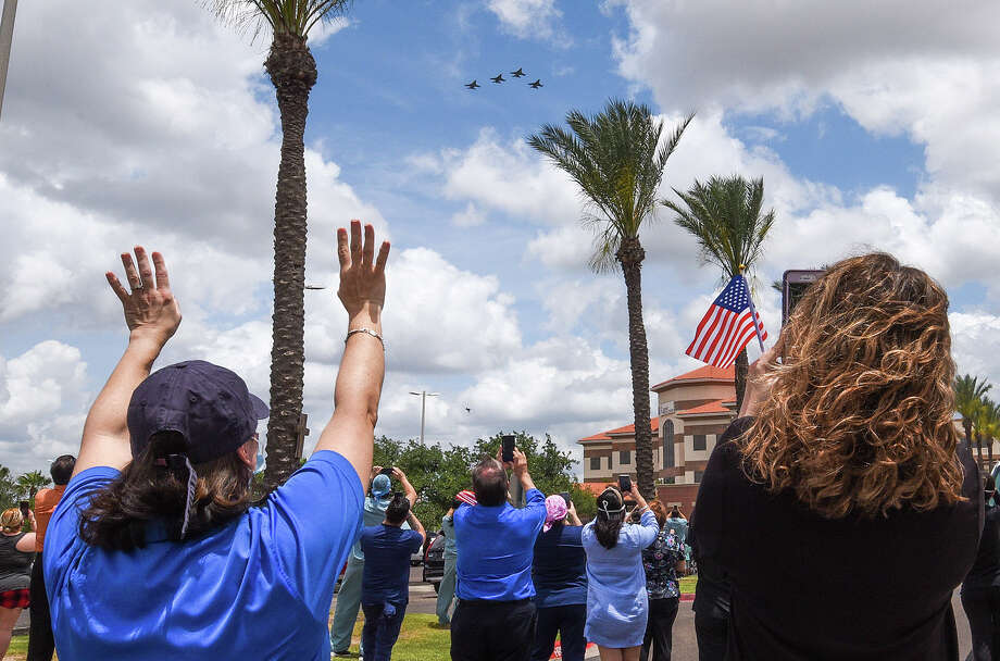 The Air National Guard's 149th Fighter Wing, consisting of four F-16s, is greeted by community members and first responders, Monday, May 11, 2020, as the planes fly over Laredo Medical Center as a tribute to frontline workers. Photo: Danny Zaragoza/Laredo Morning Times