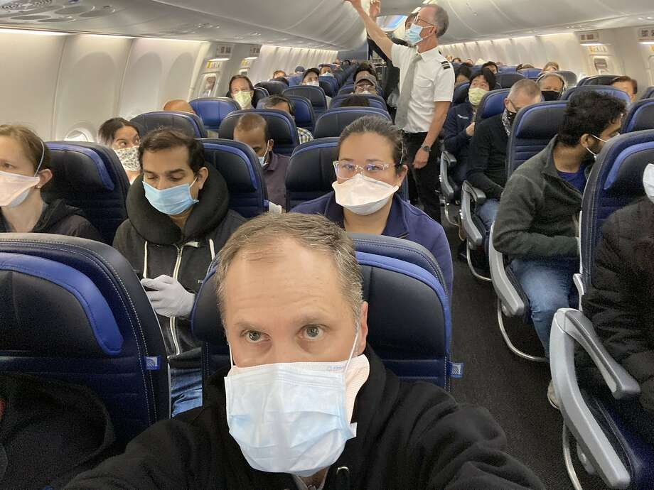UCSF cardiologist Ethan Weiss took a selfie to show a nearly full United Airlines flight to San Francisco. Photo: Ethan Weiss