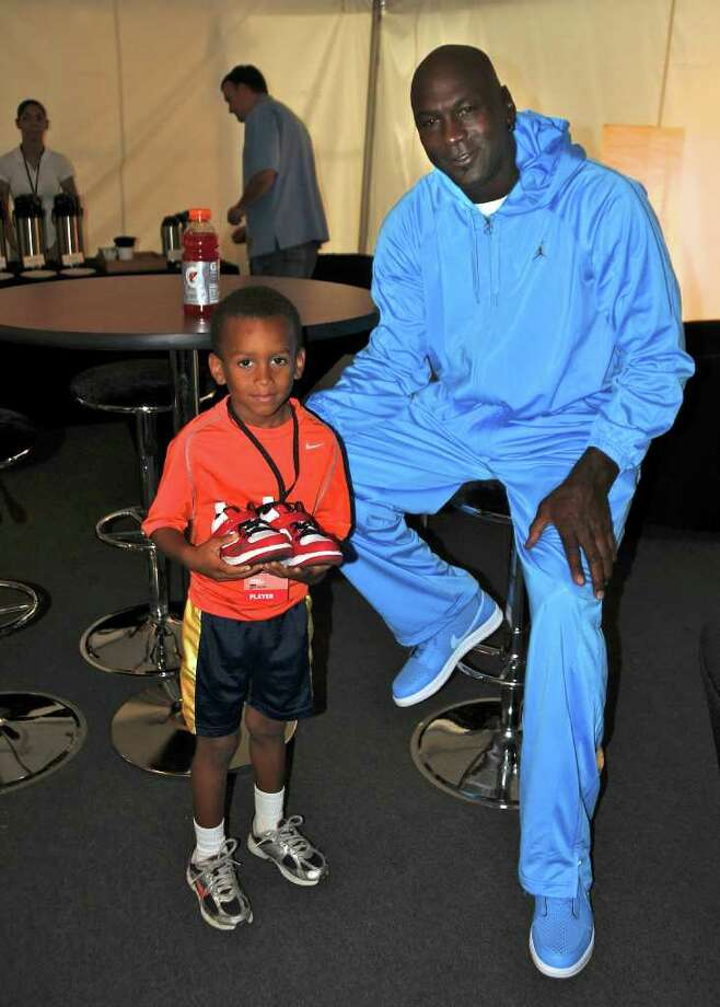 Greenwich resident Carnegie Tribble Johnson, 5, a soon-to-be first-grader at North Street School, met basketball great Michael Jordan last week at the World Basketball Festival at Rucker Park in Harlem and had his Jordan sneakers signed by the superstar. Photo: Contributed Photo / Greenwich Time Contributed
