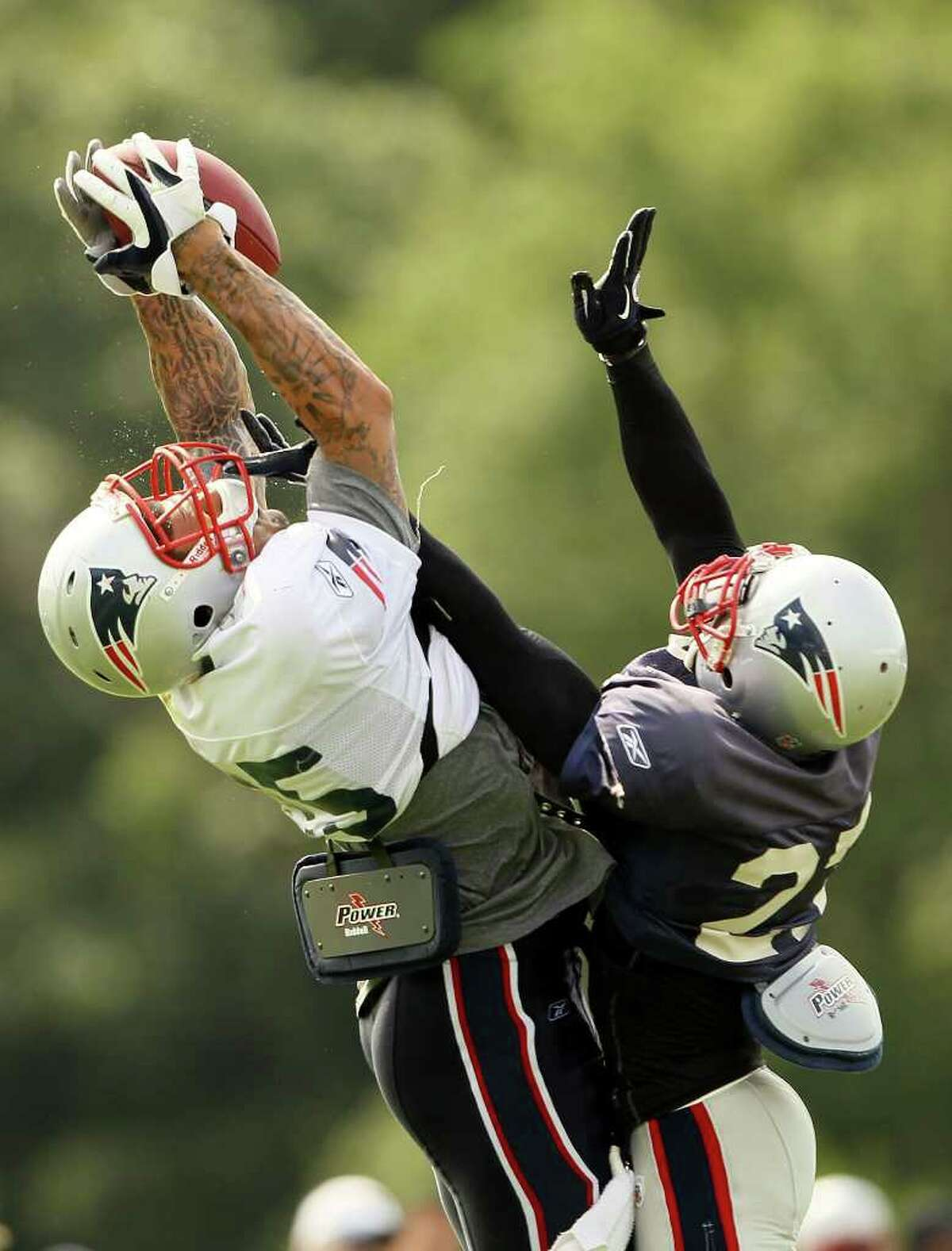 FOXBORO, MA - AUGUST 02: Aaron Hernandez #85 tries to hang on to the ball as Kyle Arrington #27 breaks up the pass during the New England Patriots training camp on August 2, 2010 at Gillette Stadium in Foxboro, Massachusetts. (Photo by Elsa/Getty Images) *** Local Caption *** Aaron Hernandez; Kyle Arrington