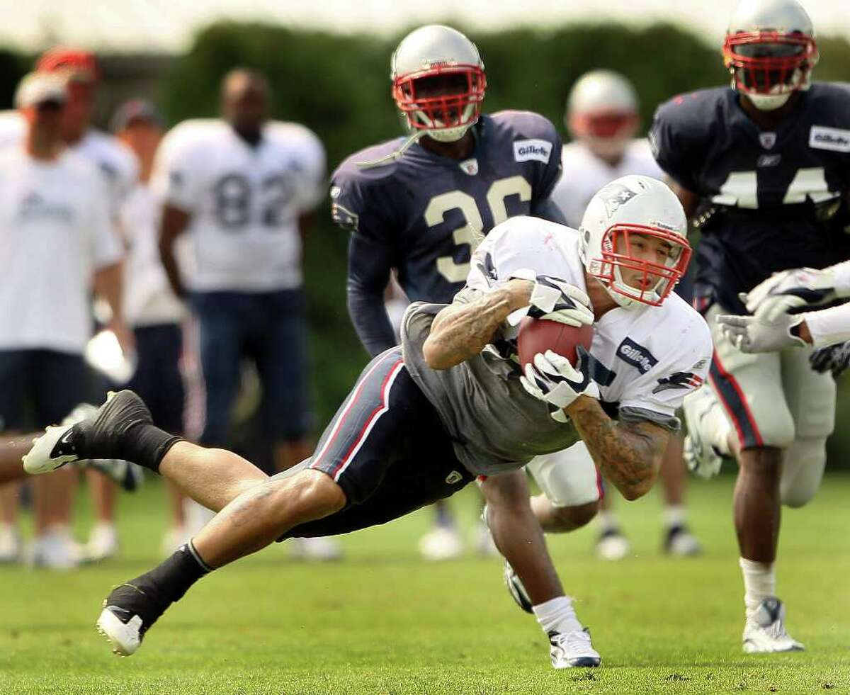 FOXBORO, MA - AUGUST 02: Aaron Hernandez #85 of the New England Patriots catches the ball during training camp on August 2, 2010 at Gillette Stadium in Foxboro, Massachusetts. (Photo by Elsa/Getty Images) *** Local Caption *** Aaron Hernandez