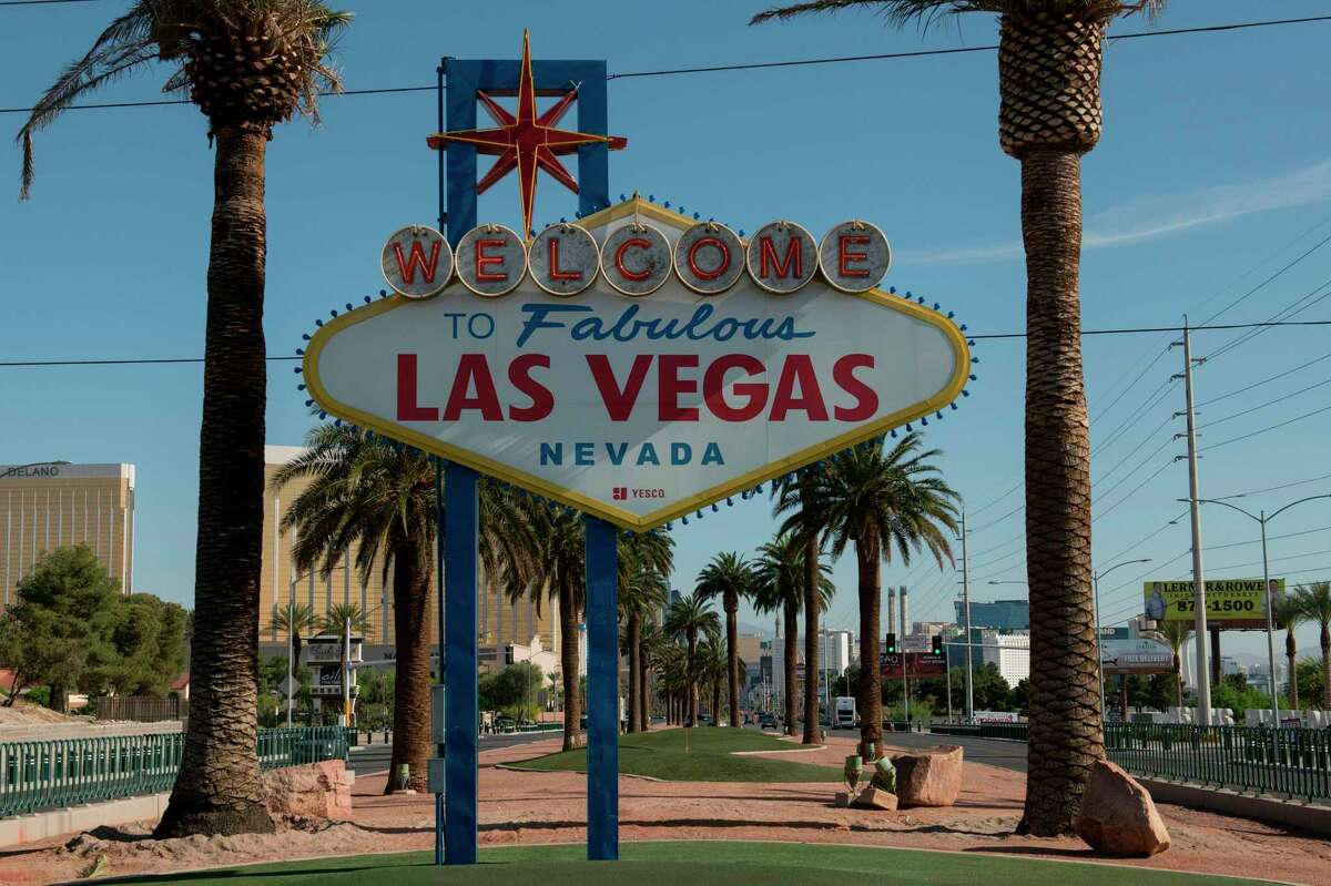 """The """"Welcome to Las Vegas"""" sign is seen on a quiet Las Vegas Strip amid the novel coronavirus pandemic."""
