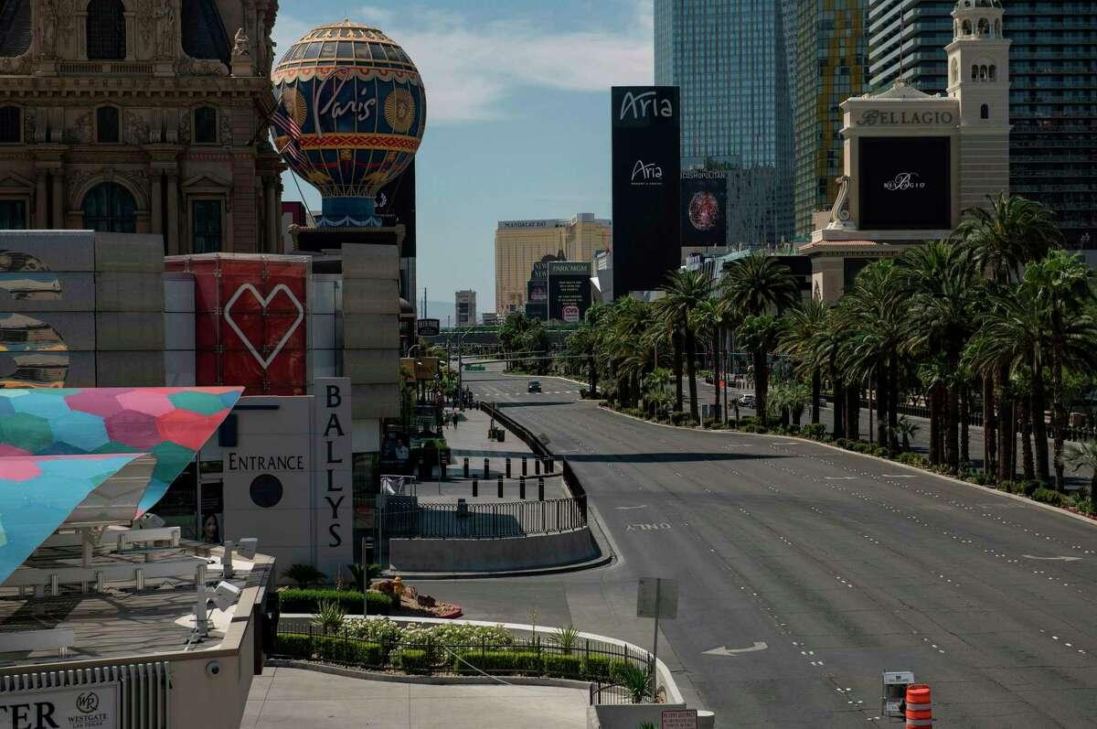 A car drives down an otherwise empty Las Vegas Strip amid the novel coronavirus pandemic.