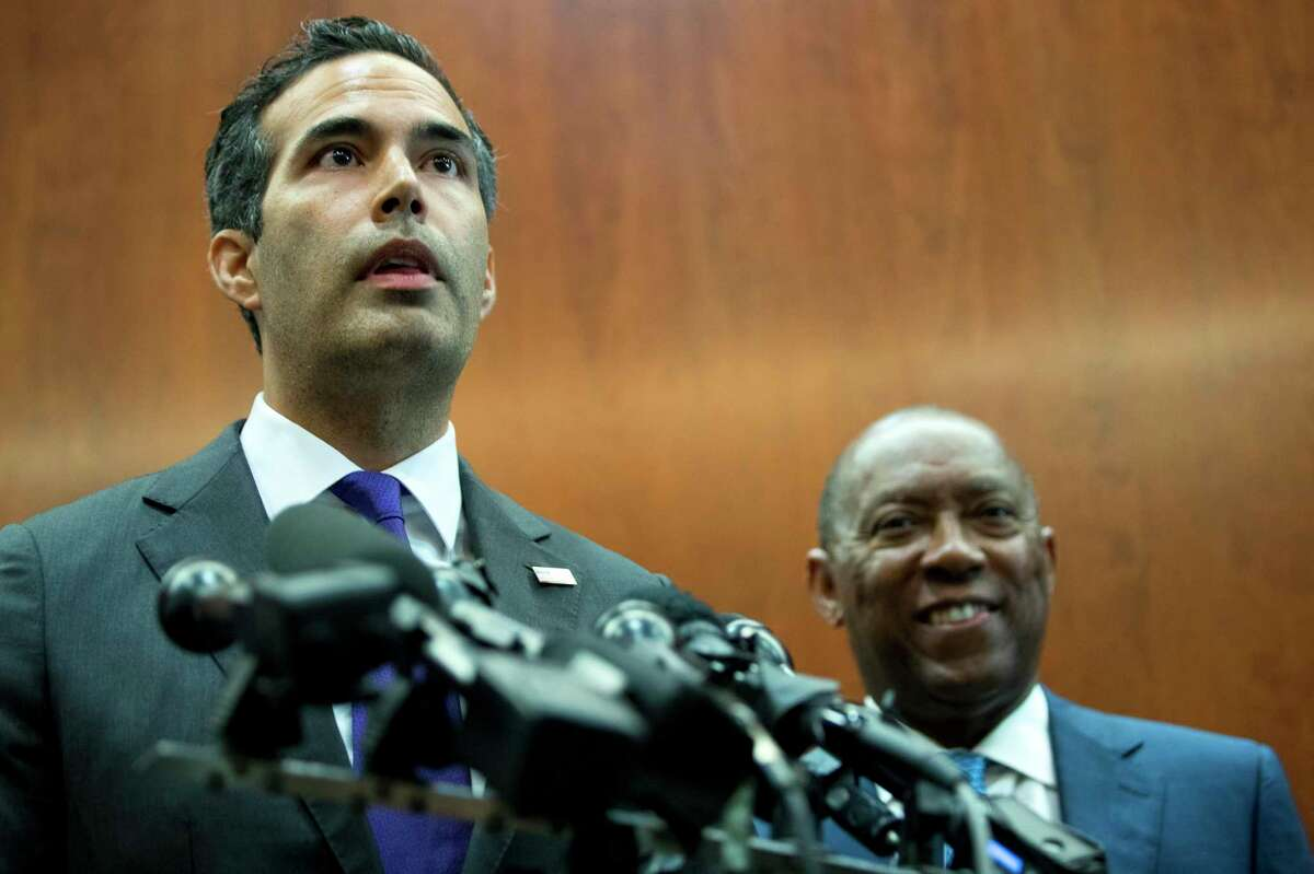 George P. Bush, commissioner of the General Land Office, stands with Mayor Sylvester Turner as he discusses long-term Hurricane Harvey recovery funds during a news conference at the Houston City Hall Annex on Thursday, June 28, 2018, in Houston. The recovery efforts include the first round of funding for buyouts through CDBG-DR funds.( Brett Coomer / Houston Chronicle )