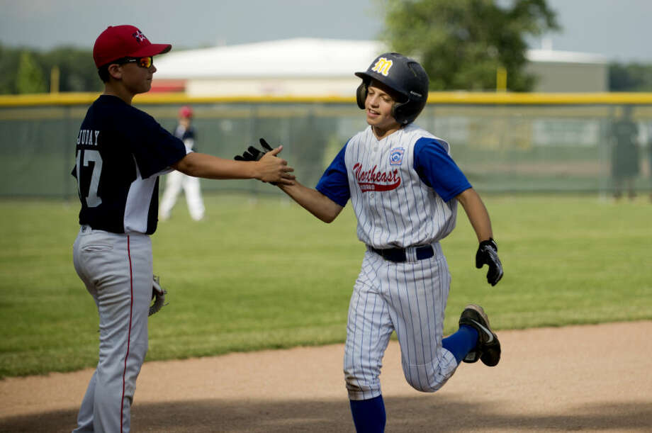 Fraternal Northwest's Shane Juday congratulates Northeast's Matthew Babinski after the latter hit a home run in a June 30, 2014 game. Photo: Daily News File Photo