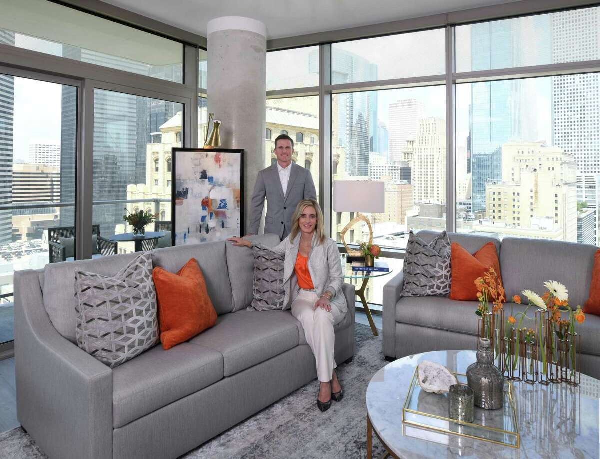 Cheryl and John Brady keep an apartment in downtown Houston. The Astros fans decorated their apartment with blue and orange accents as a nod to their favorite team.