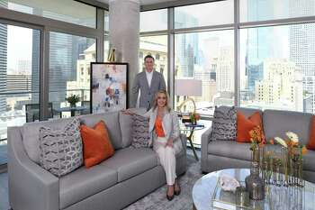 Cheryl and John Brady keep an apartment in Houston. The Astros fans decorated their apartment with blue and orange accents as a nod to their favorite team.