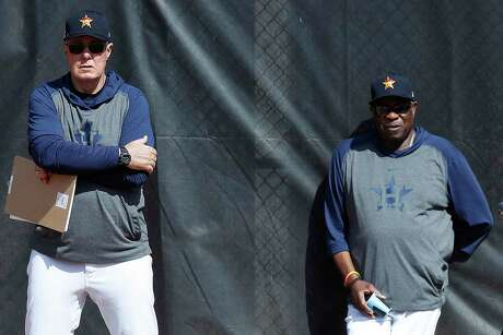 The world has changed since pitching coach Brent Strom, left, and manager Dusty Baker were getting their first glimpses of the 2020 Astros in February.