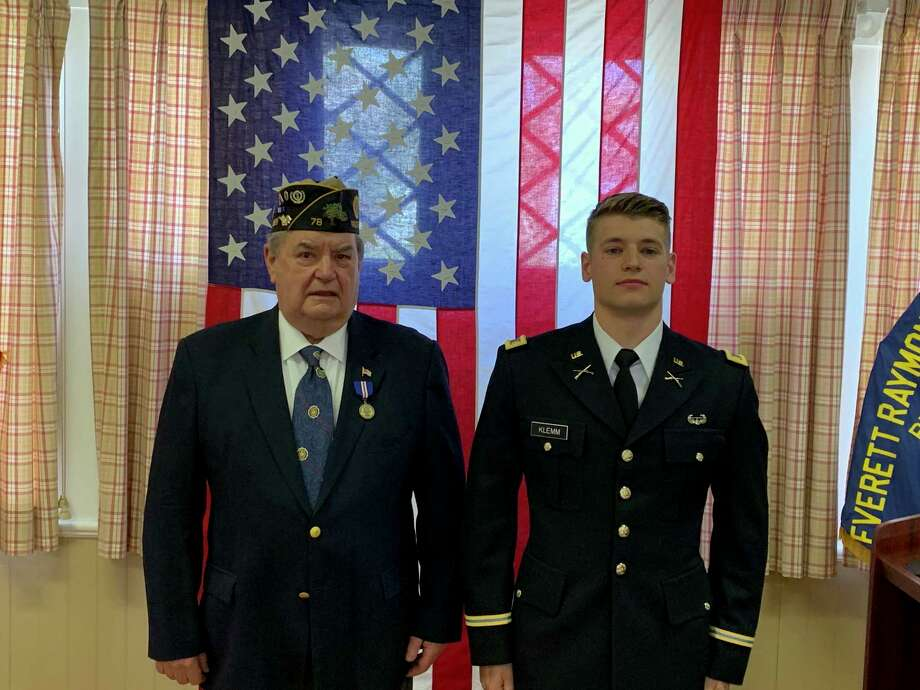American Legion Post 78 Commander George Besse was honored with Second Lietenant Kristopher Klemm's first salute as an officer. Photo: Contributed Photo