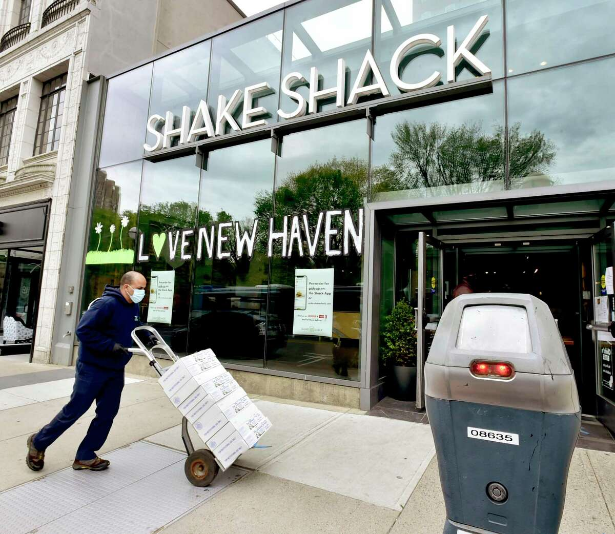 A delivery is made by Pat LaFrieda Meat Purveyors Monday, May 11, 2020, to the Shake Shack in New Haven near a parking space in front of the restaurant. One of the ways the city can enable more outside table service is with the use of