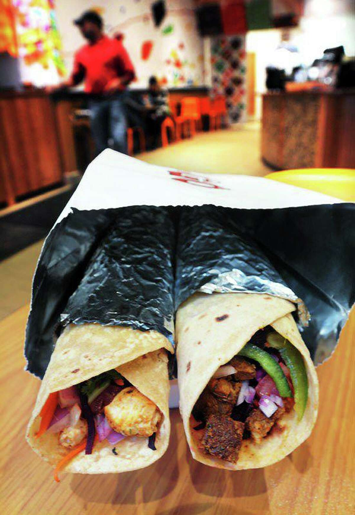 Two roti wraps, one with chicken tikka, left, and lamb kebab, right, at the Tikkaway Grill in New Haven, which has participated in the city's parklet program.