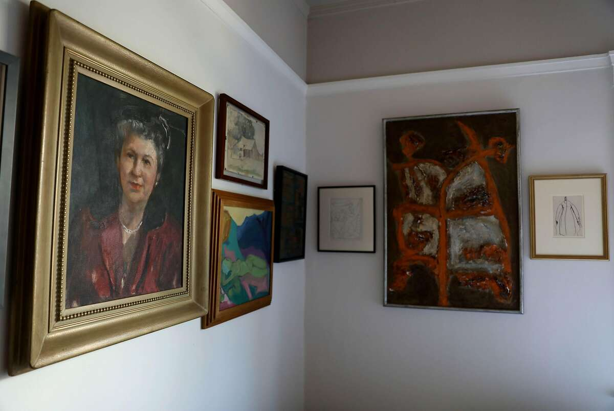 Interior of a home owned by Rob Delamater and his husband Craig Daniel on Wednesday, May 6, 2020, in Oakland, Calif. The couple created gallery walls in their home featuring art from 20th century artists from Delamater's gallery, Lost Art Salon, located in San Francisco. Some of the pieces are from Delamater himself.