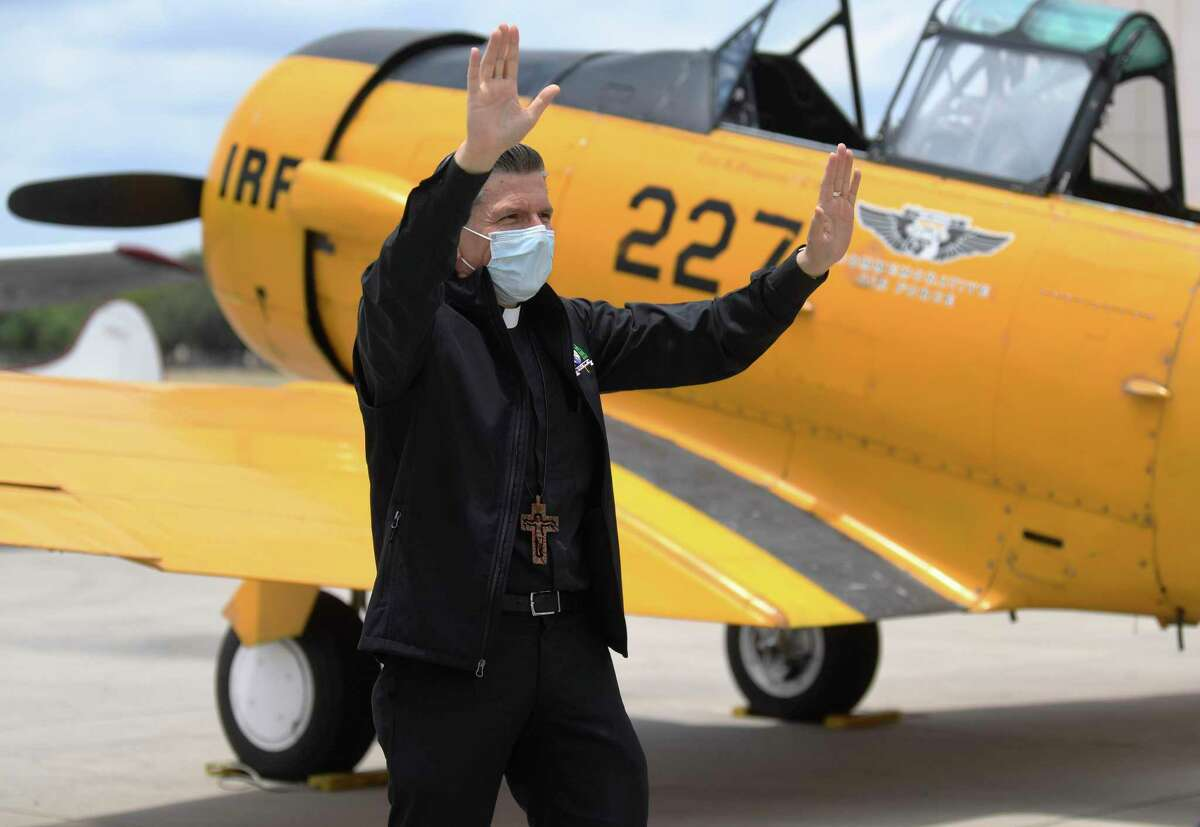 Garcia-Siller arrives to board the vintage 1942 SNJ Texan airplane.