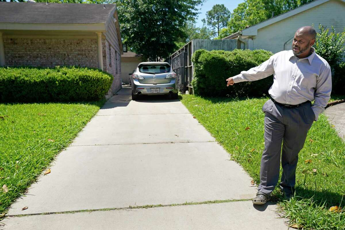 Robert Pringle stands outside his home Thursday, April 30, 2020, in Houston where a bullet was found nearby a bullet hole in his backyard garage door after his neighbor, Joshua Johnson, was shot and killed by a Harris County Sheriff's deputy in the 15000 block of E. Ritter Circle on April 22.