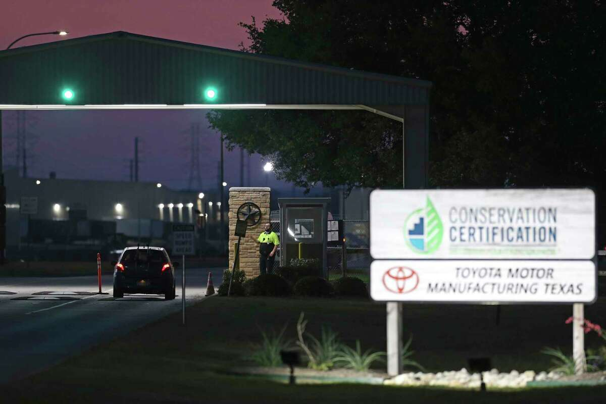 A guard checks traffic going into the San Antonio Toyota plant, Monday, May 11, 2020. Toyota's 12 plants, including the U.S. and Canada, have been closed since March 23 in what originally was supposed to be a two-day closing to sanitize the plants to protect workers from the coronavirus pandemic. The company planned on reopening the plants on May 4 but pushed the date to May 11.