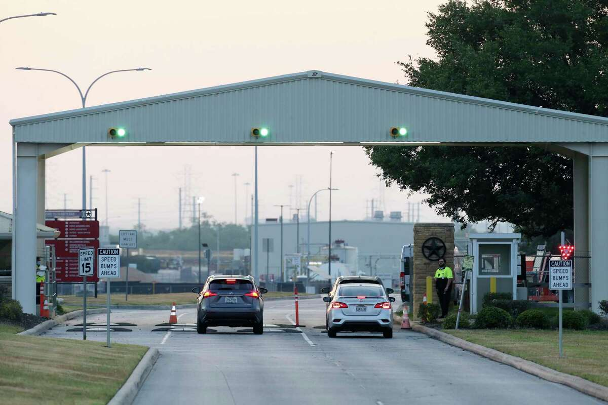 Traffics goes through a check point at the main entrance to the San Antonio Toyota plant, Monday, May 11, 2020. Toyota's 12 plants, including the U.S. and Canada, have been closed since March 23 in what originally was supposed to be a two-day closing to sanitize the plants to protect workers from the coronavirus pandemic. The company planned on reopening the plants on May 4 but pushed the date to May 11.
