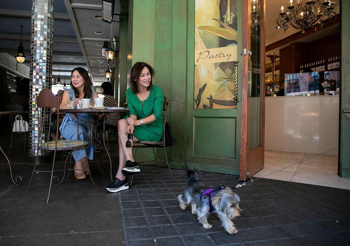 From center right, Connie Le and her sister Susan Nguyen socialize over coffee at Cocola Bakery on Santana Row on Tuesday, August 27, 2019 in San Jose, Calif.