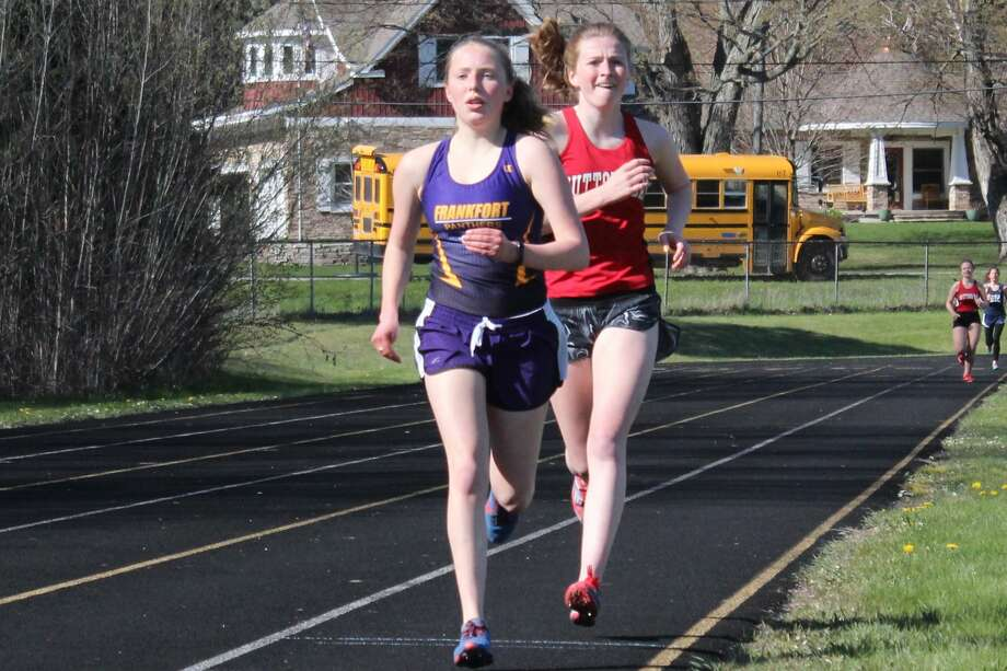 Janey Turner races in the 1600-meter run during her junior, and final, track season for the Panthers. Photo: Robert Myers