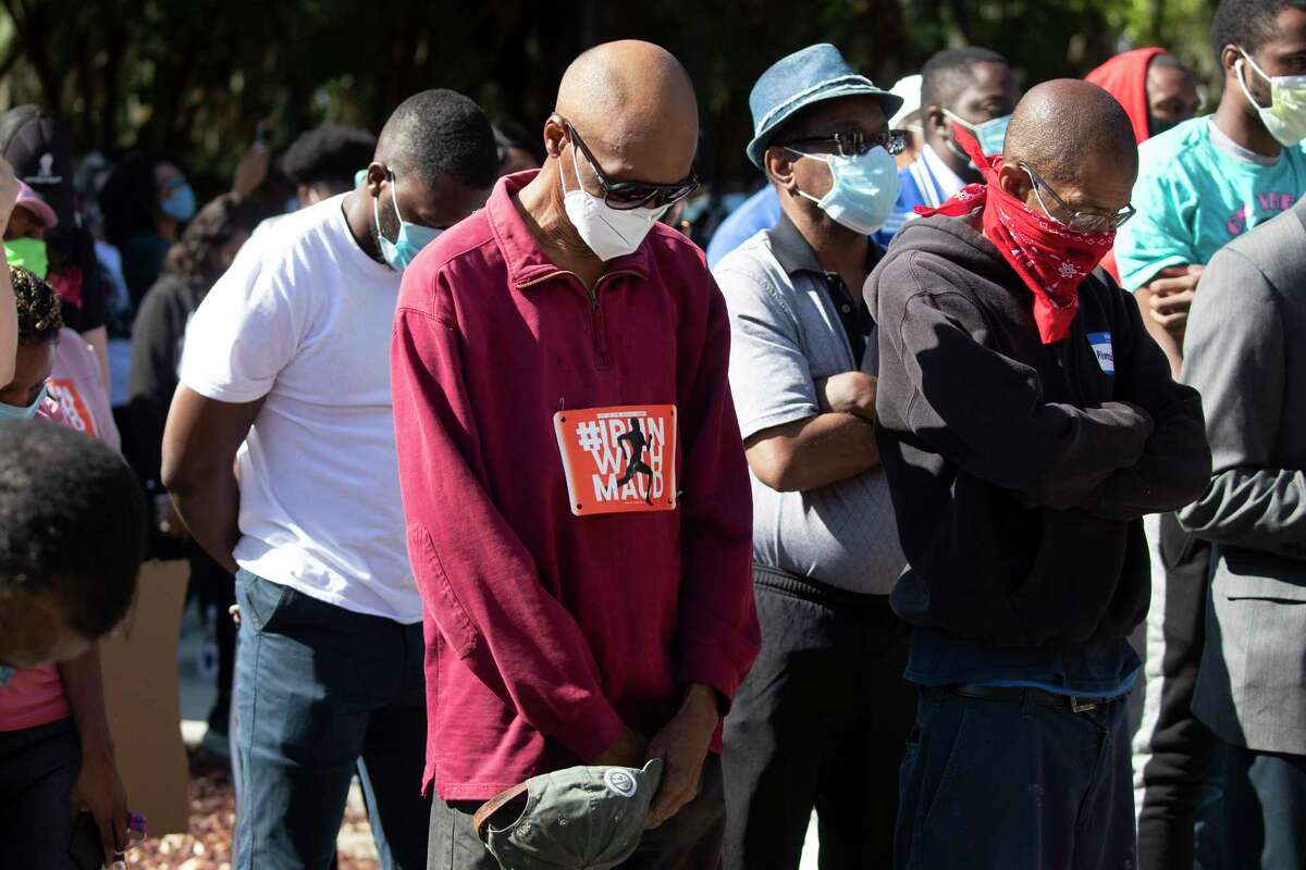 REMOVES a€œUNARMEDa€ AND ADDS THAT AUTHORITIES HAVE NOT CONFIRMED THAT ARBERY WAS EITHER ARMED OR UNARMED - People pray during a rally to protest the shooting of Ahmaud Arbery, Friday, May 8, 2020, in Brunswick Ga. Two men have been charged with murder in the February shooting death of Arbery,A a black man in his mid-20s, whom they had pursued in a truck after spotting him running in their neighborhood. (AP Photo/John Bazemore)