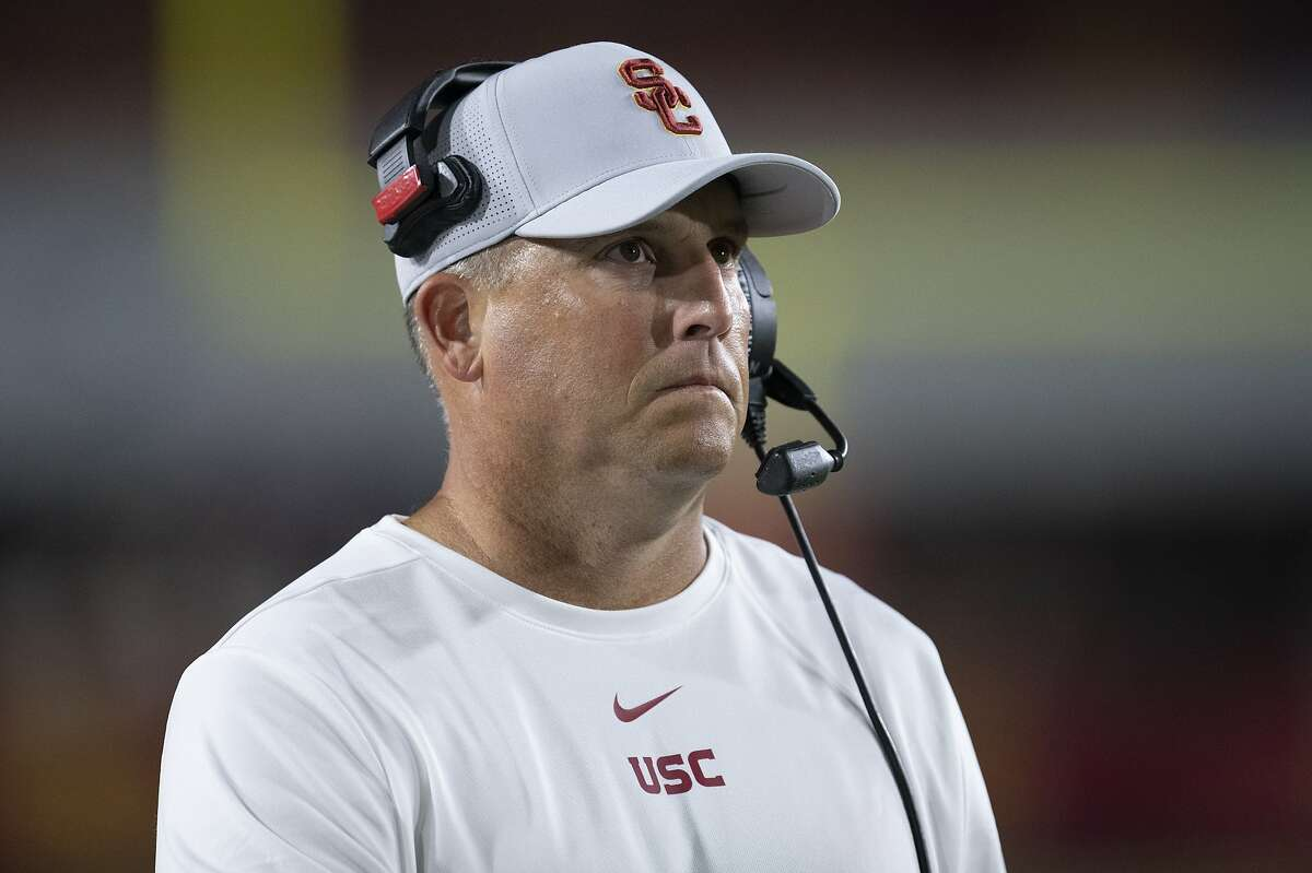 FILE - In this Sept. 31, 2019, file photo, Southern California head coach Clay Helton watches an NCAA college football game against Fresno State in Los Angeles. The Pac-12 has discussed the possibility of moving to an 11-game, all-conference schedule this year amid the unprecedented uncertainty of the coronavirus pandemic, Helton says. Stanford's David Shaw also says he does not necessarily agree with NCAA President Mark Emmert's belief that college campuses should be open for college sports to resume. (AP Photo/Kyusung Gong, File)